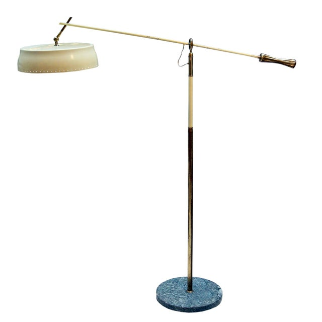 An articulating and movable shade, cream color enamelled with brass details, made base. design by Angelo Lelli ca. 1950...