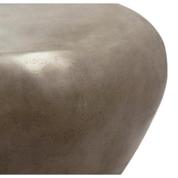 Organic modern style coffee or side table or stool in the shape of a pebble. Made from lightweight cement resin and works...