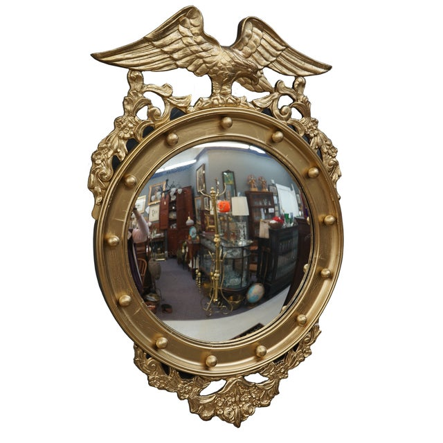 Carved wooden eagle and floral details that have been gessoed and gilded. Convex mirror plate. Overall great condition...