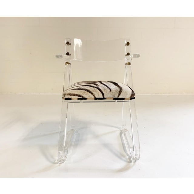 Lucite and zebra. What a cool look. This is the perfect desk or vanity chair. A smaller scale, with arms! So very chic.