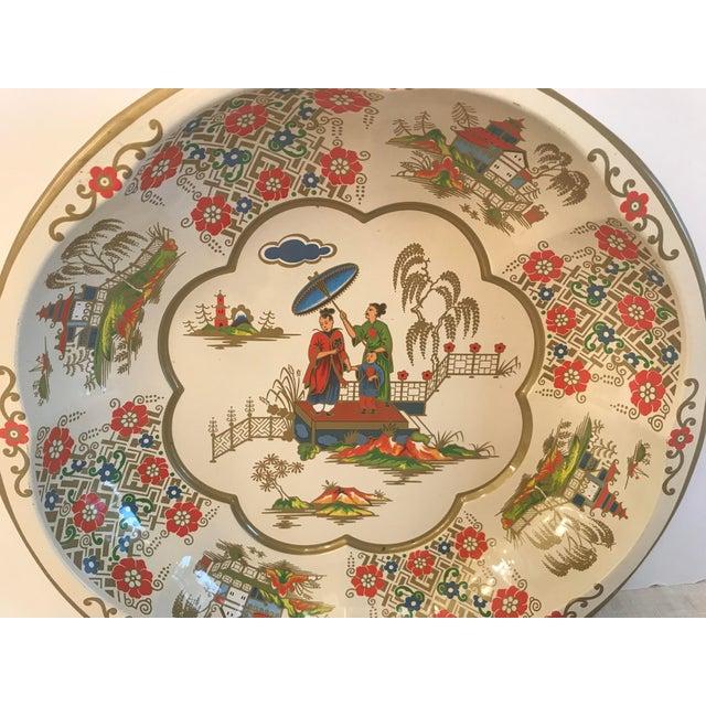 Nice oriental scenes on this Imari Colored Vintage English tin bowl.