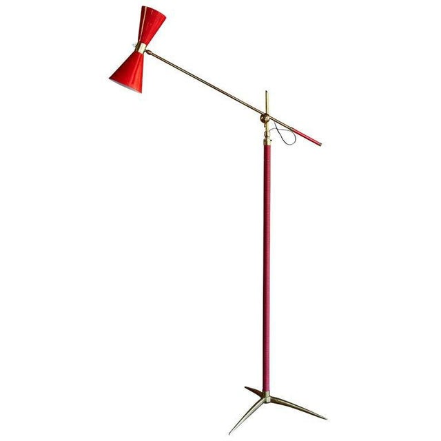 1950s French red articulating floor lamp. Executed in red painted metal, red vinyl and brass. An interesting amalgam of...