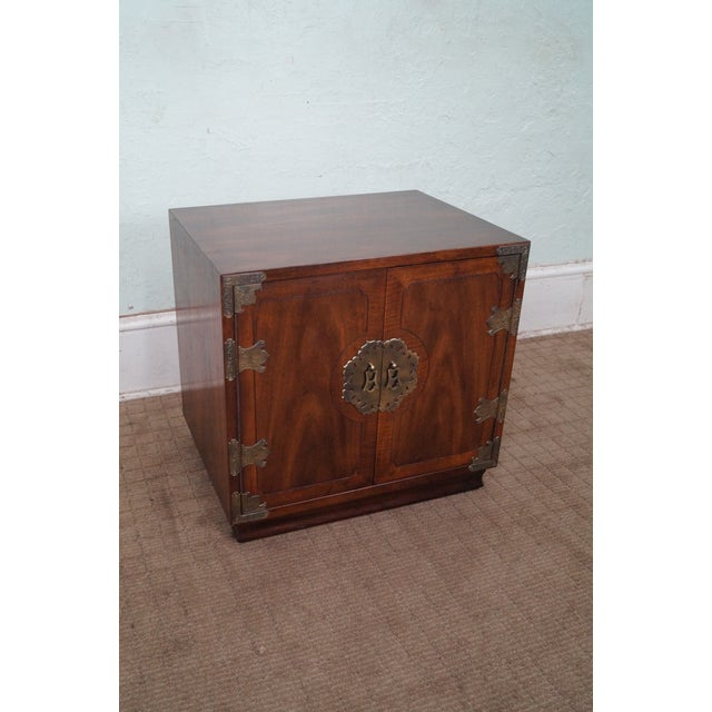 A Henredon Asian influenced Mahogany cabinet nightstand that is thirty years old and was made in America. Store Item #: 8971