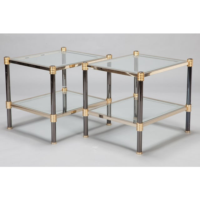 These mid century pair of side tables date from the 1970s and are attributed to Roche Bobois. Each table features two...