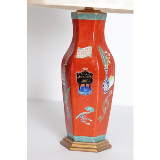 Early 19th century, Chinese porcelain six sided vases as lamps with pleated shades. Beautiful red painted background with...
