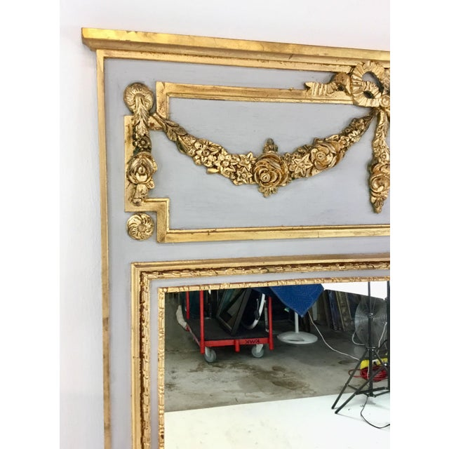 Stylish Ave Home Neoclassical style gray and gold leaf trumeau wall mirror, hand applied gold leaf, showroom floor sample