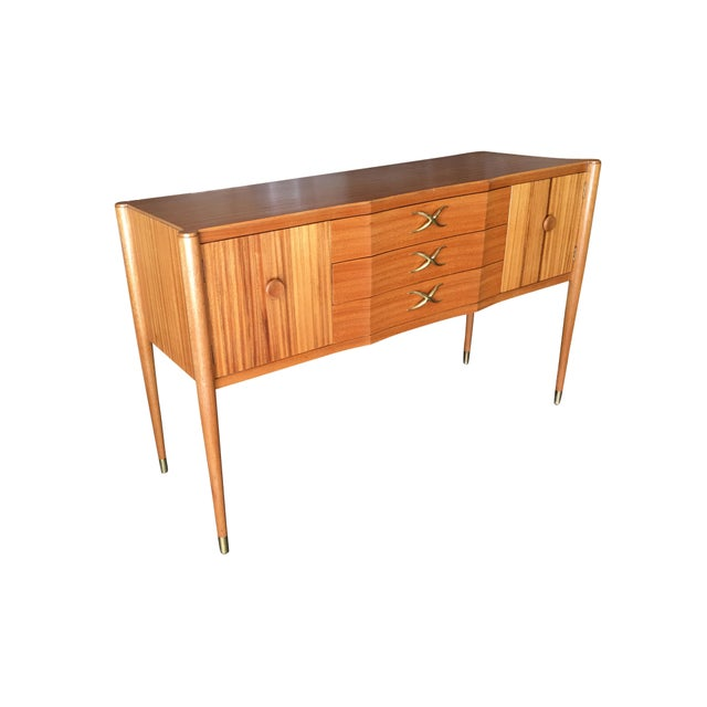 Mid Century mahogany sideboard by Paul Frankl featuring a slender cabinet on petite taper legs with 3 drawers and 2 front...