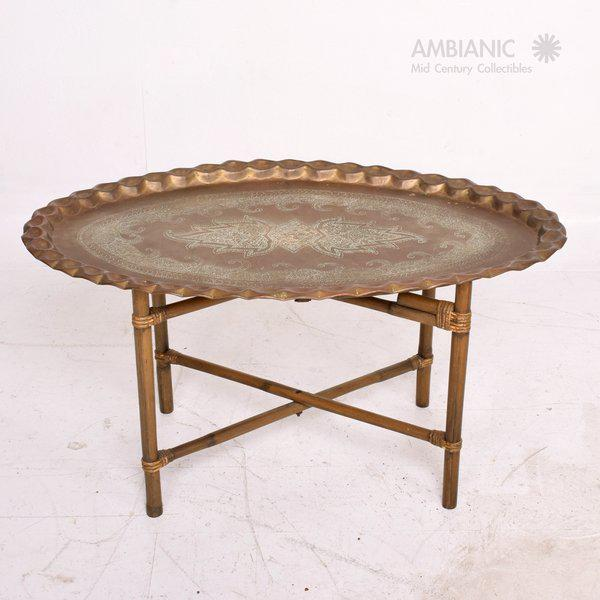 For your consideration a vintage coffee table made of bamboo base and scalloped brass tabletop in oval shape. Original...