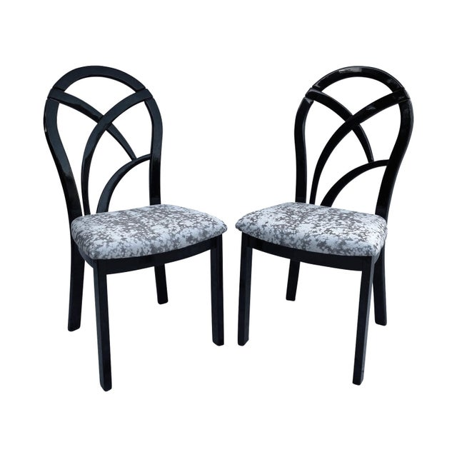 Set of four 1980s Italian black lacquer dining or game table chairs newly reupholstered in a modern jacquard fabric with a...