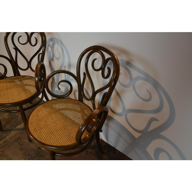 Pair of Italian bentwood chairs with cane seat.