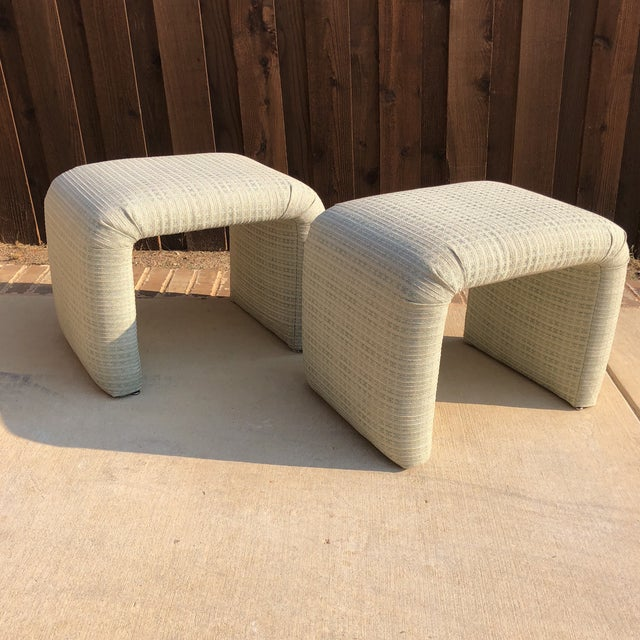 Gorgeous pair of vintage waterfall stools in the palest shade of green. Fabric has texture woven into it, with white and a...