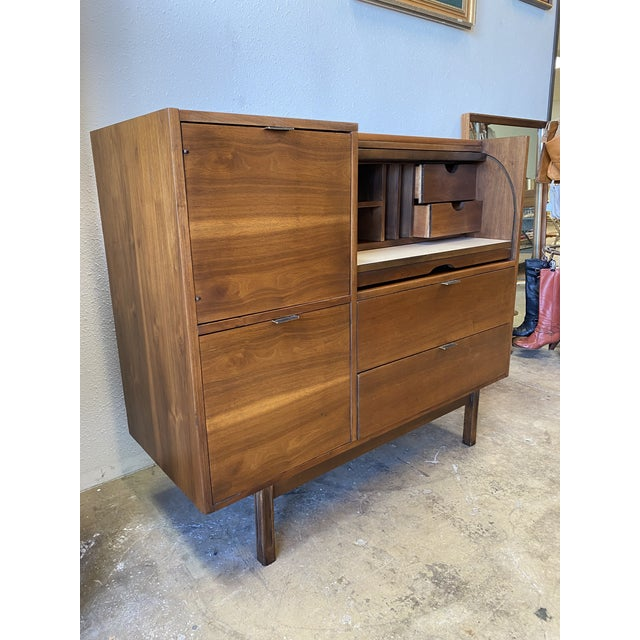 Gorgeous Mid century roll top vintage modern secretary desk includes a tambour roll top with hidden additional storage and...