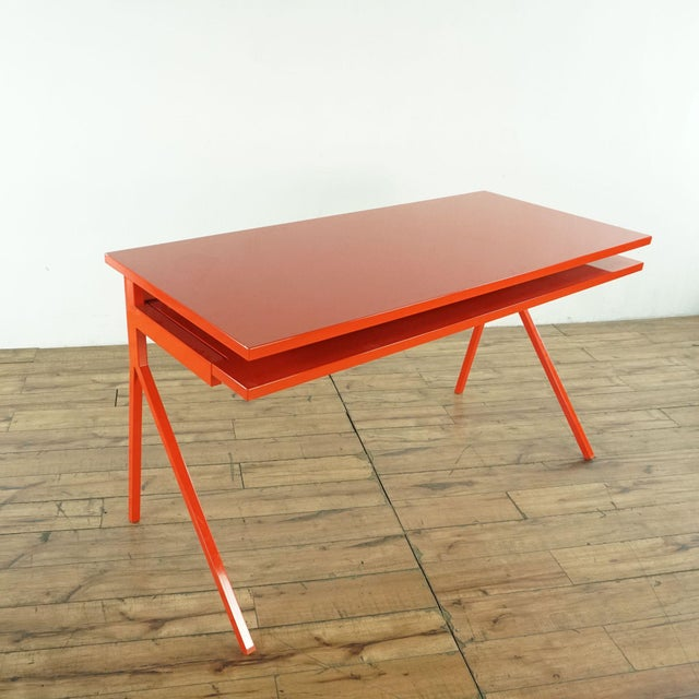 The BluDot Desk offers an uncluttered surface and a keyboard tray. What else do you need to finish the great American...