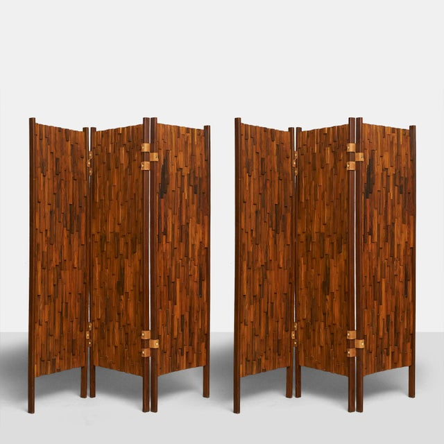 Folding screens in lapped rosewood with leather hinges (in the style of Percival Lafer) A pair of room dividers from...