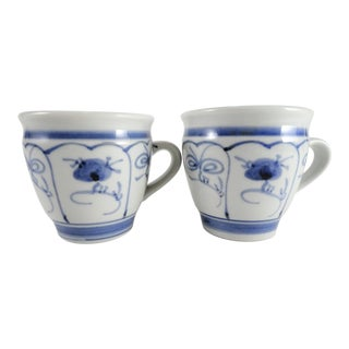Hand Painted Blue and White Mugs - a Pair For Sale