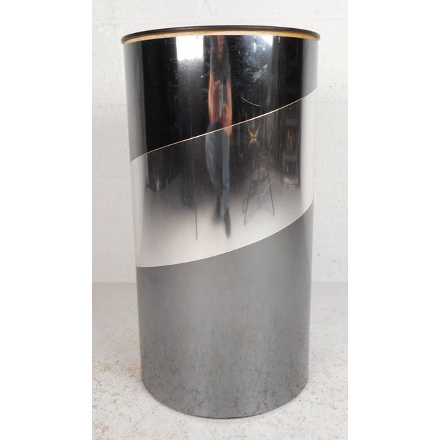 Stunning vintage modern pedestal features a cylinder shape layered with chrome strips and a mirrored top. Unique design...