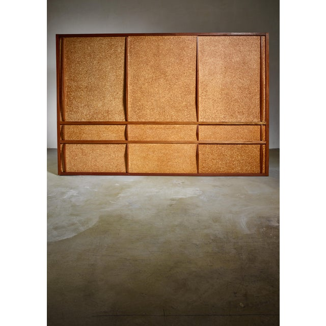 A rare and complete cupboard, designed by Charlotte Perriand and produced at Ateliers Jean Prouvé. This piece was designed...
