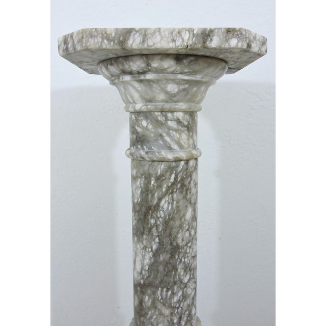 Classical grey and white Italian marble two piece, heavy column or pillar. Square top with truncated corners, and...