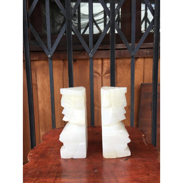 Beautiful pair of vintage Marble Aztec bookends, have identical faces. has a nice look to them can be used as bookends or...