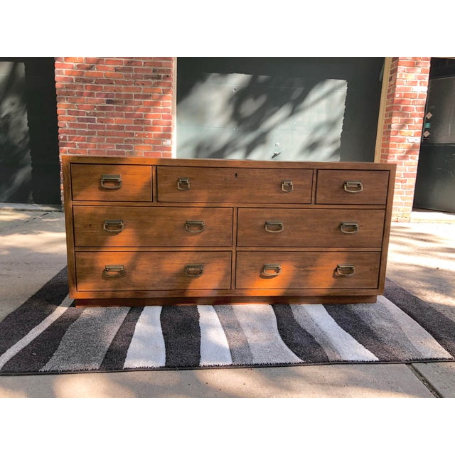 Vintage Windwood by Drexel Campaign seven drawer dresser. This has gorgeous brass fixtures. The grain work on this is...