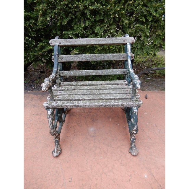 A late 19th century cast iron and wood seat garden chair by Coalbrookdale The garden chair maintains an old worn painted...