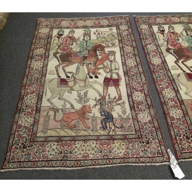 This is a pair of handmade rugs made of 100% wool. The pieces date back to the 1880s.