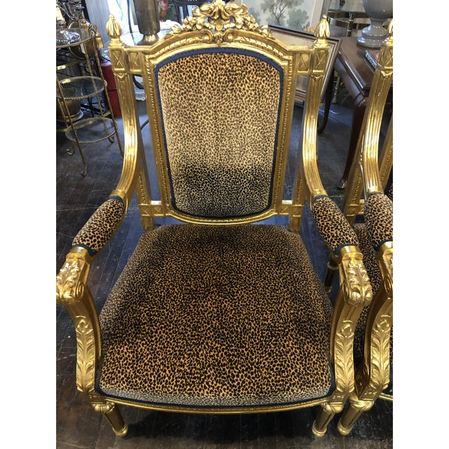Pair of Swanky cheetah print arm chairs to match sofa in our shoppe. Gold gilt frame floral detail on head and leaf carved...