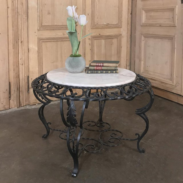 Mid-Century French Wrought Iron Marble-Top Coffee Table not only presents the carefree elegance of a marble top, it is...