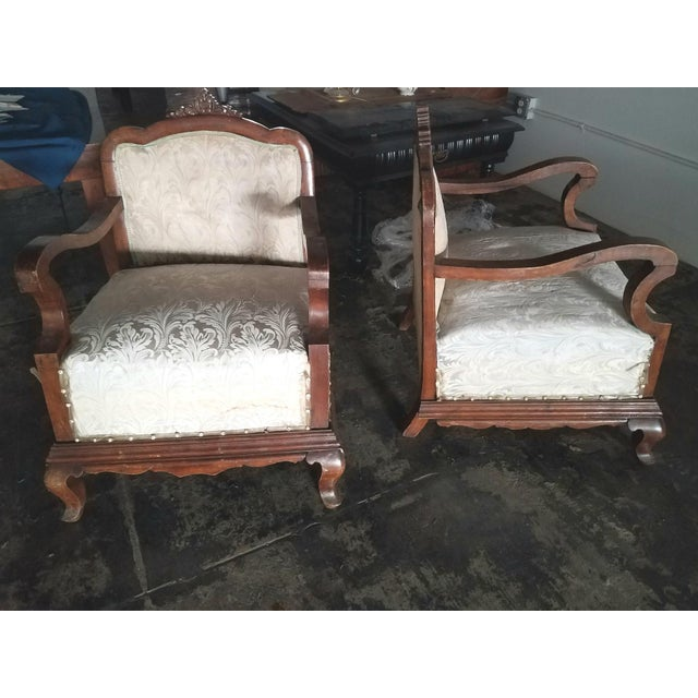 Italian pair of chairs in original antique condition. Walnut base and coil springs.