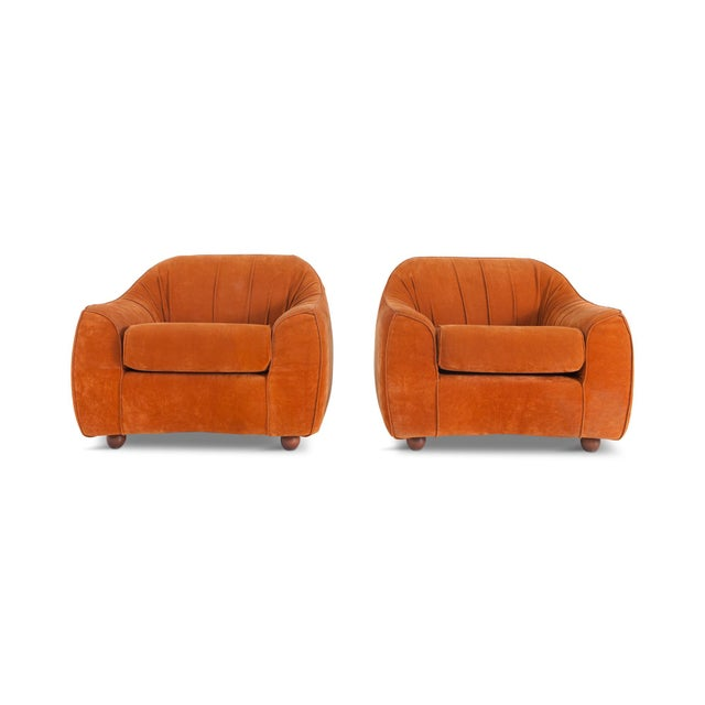 Vintage orange Italian Poltronas. A set of four space age club chairs from the sixties. The original suede upholstery is...