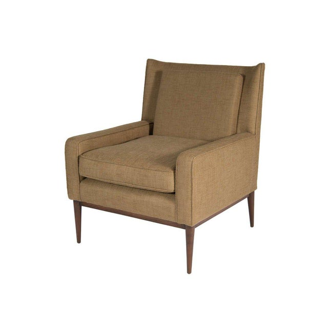 """Mn Originals high back lounge chair with matching ottoman measuring at W 30"""", D 18.5"""", H 15"""". The chair is detailed with..."""