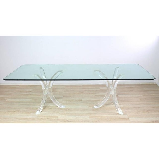 """Very nice Mid-Century Modern dining or conference table. The thick 3/4"""" glass top sitting on two heavy lucite """"tusks"""" bases."""