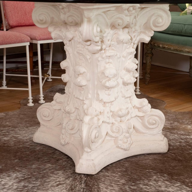 A spectacular dining table with a painted cast concrete sculptural base with a round beveled glass top. Light and airy,...