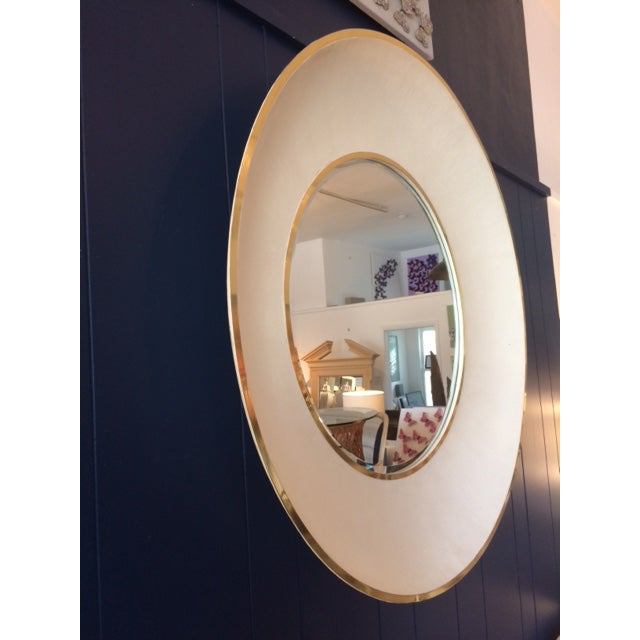 Large modern round mirror with shagreen styled tiles and gold metal banding create this important decorative piece.