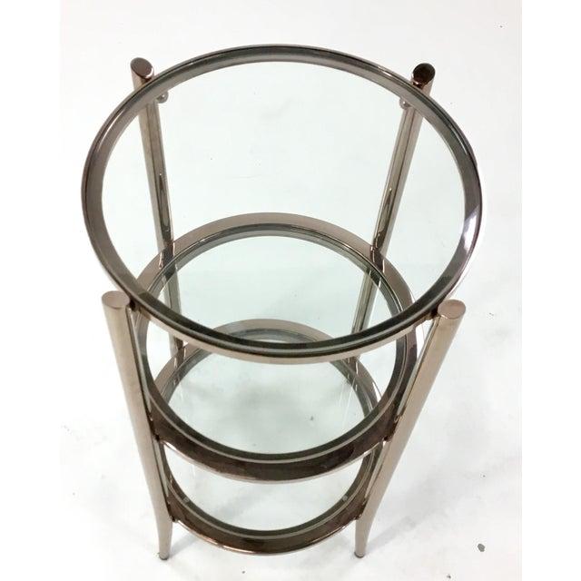Stylish modern Caracole You Make Me Blush occasional table, rose gold finish, three glass shelves
