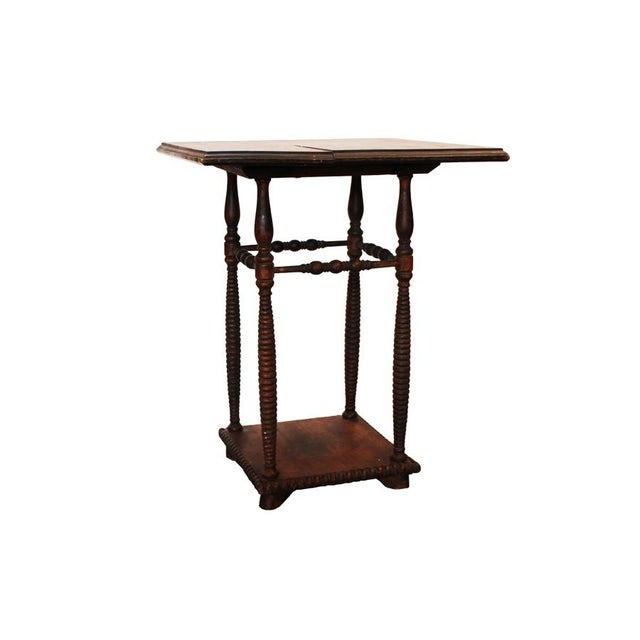 An antique Victorian spindle leg side table. The table has a small blemish on the top, shown in the third image. Local...