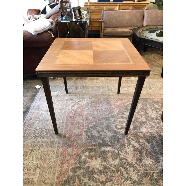 Vintage mid century card table with marketry wood inlaid top and folding legs for easy storage. Mixed wood inlay,...