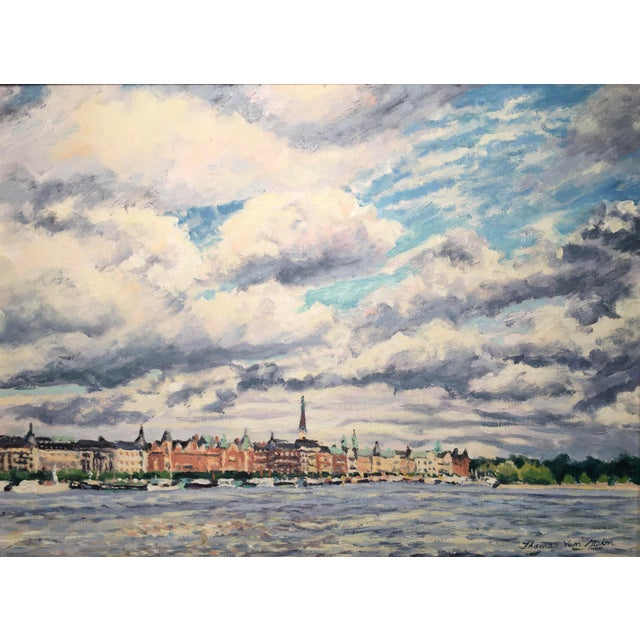 A lovely image of Stockholm, Sweden. This very pleasing painting has a complementary mat and silver toned frame and is...