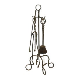 American Mission style (early 20th Cent) wrought iron set of 4 fire tools on a stand with 4 scroll base feet and ring top