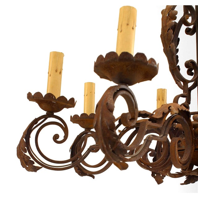 Italian Renaissance style (20th century) wrought iron chandelier with eight scroll design arms and leaf trim.