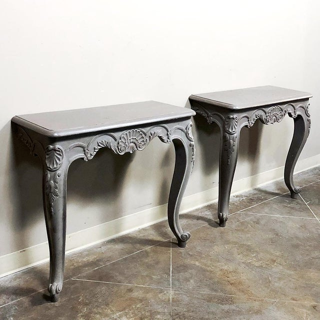 Pair 19th Century French Louis XV Painted Consoles feature Louis XV styling, cabriole legs, hand-carved embellishment and...