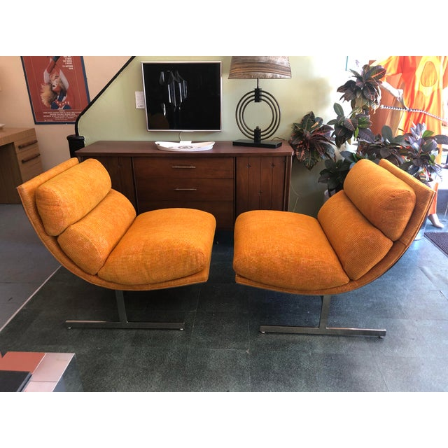 You are viewing a fantastic PAIR of Polished Steel Scoop Chairs, designed by Kipp Stewart for Directional c1970s. These...