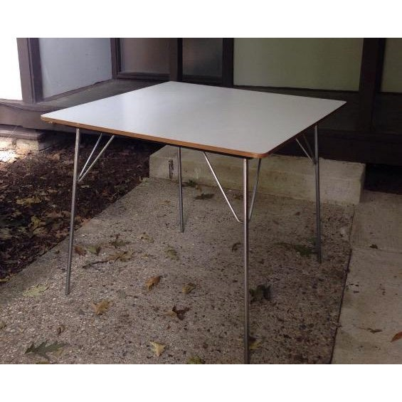 Excellent example of the rare square DTM 20, (Dining Table, Metal legs) designed by Charles and Ray Eames and produced by...
