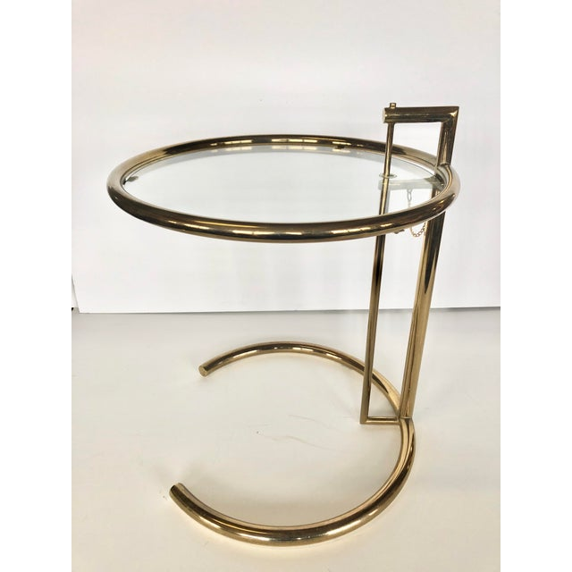 "Modern brass and glass side table ""E 1027"" by French based designer Eileen Gray. Height adjustable 24.5""-34"""
