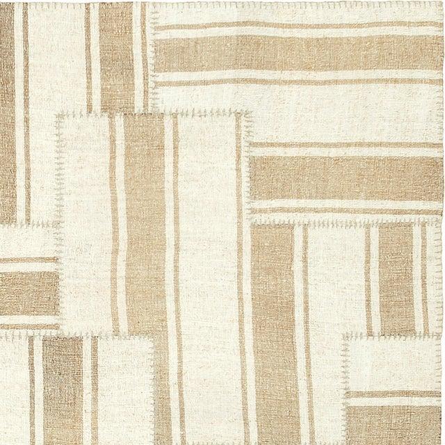 Vintage kilim composition - The Gate design. Vintage Turkish panels, coarse weave, oatmeal with soft camel color stripes....
