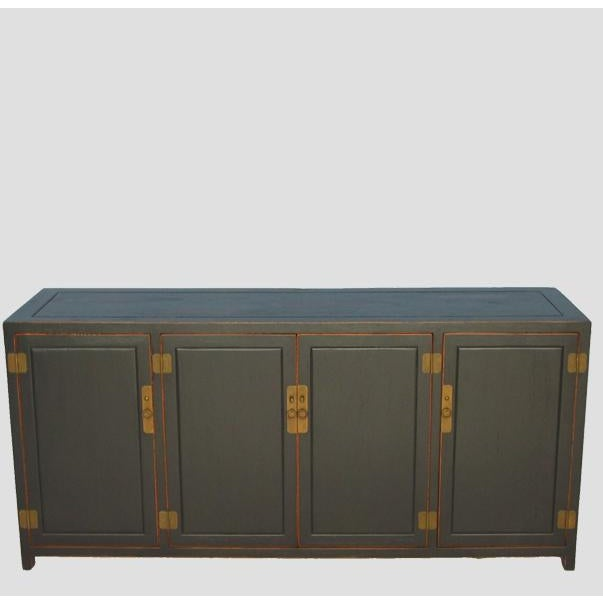 Finished in muted antique black lacquer with distressed edges and top, this sideboard gives the beholder a sense of...