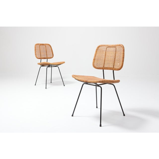 Mid-Century Modern elegant and feminine dining chair for Rohe in the 1950s. The cane and wicker seating and black metal...