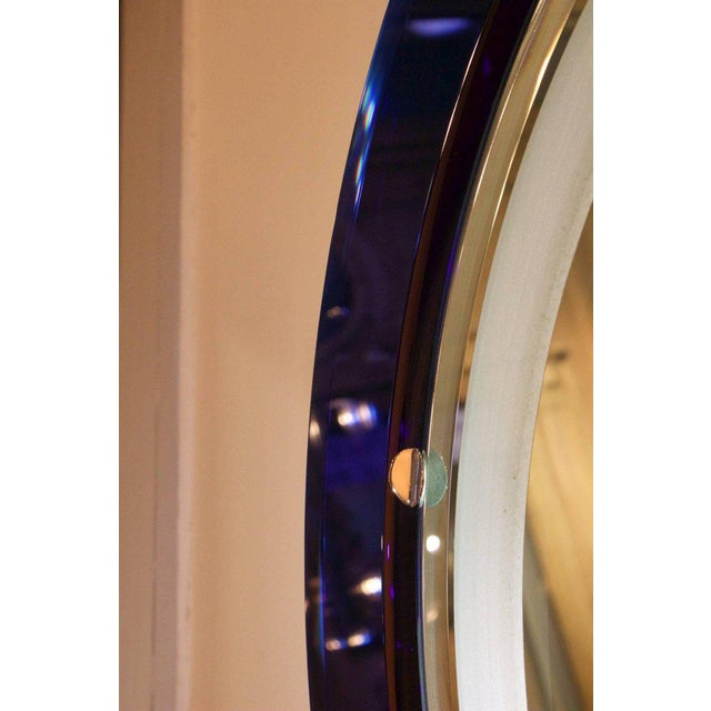 Very unusual mirror with a cobalt blue and white glass frame. The mirror has a backlight, Italian, 1970s.