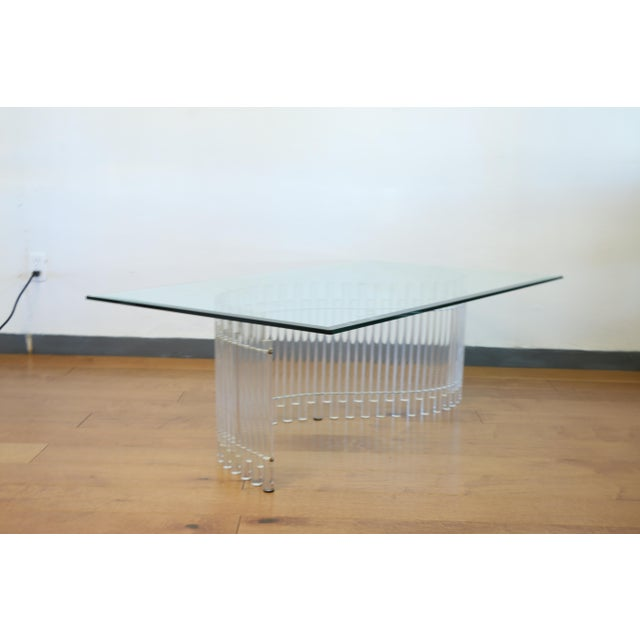 Vintage contemporary lucite s shaped base with glass top. Lucite base has brass accents at the bottom of the base.. Table...