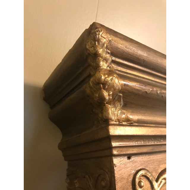 This beautiful antique gilt fireplace mantel topper will make an elegant addition to any fireplace. The bust in the middle...